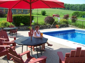 Relax by the pool at Fieldstone Farm.