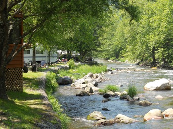 Campsite by the river at Yogi Bear's Jellystone Resort Cherokee.