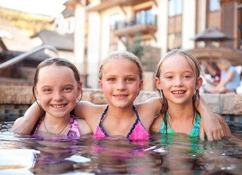 Swimming Buddies at The Sebastian Vail enjoying the mountain view pool.