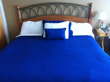 Guest bed at Weathervane Inn.