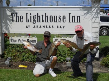 Lighthouse Inn at Aransas Bay sign