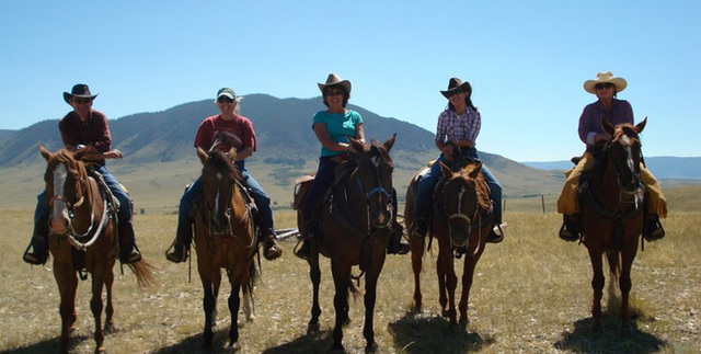Group horseback riding at Vee Bar Guest Ranch.
