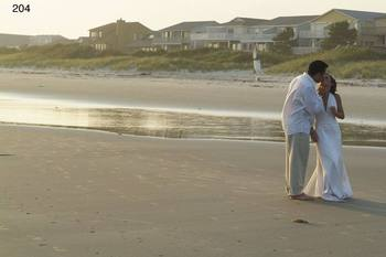 Wedding couple on beach at The Sunset Inn.
