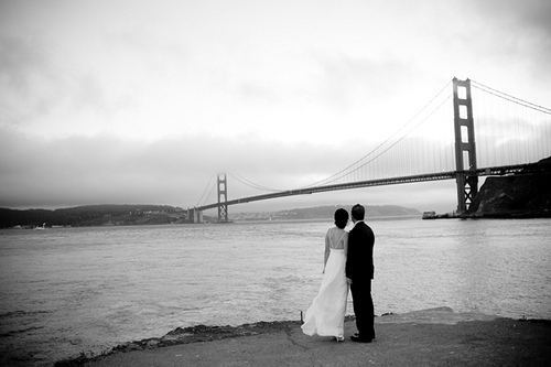 Wedding couple view the San Fransisco bridge near Cavallo Point Lodge.