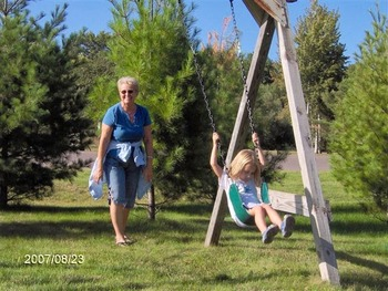 Swinging with grandma at Woodside Cottages of Bayfield.
