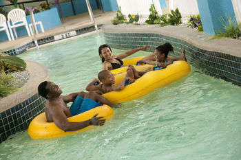 Family on lazy river at Landmark Resort.