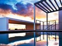 An infinity pool-reflected South Beach sunset.