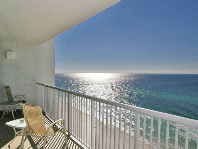 Balcony overlooking ocean at Southern Vacation Rentals.