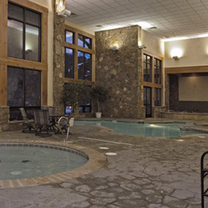 Indoor pool and whirlpool at Grand Timber Lodge.