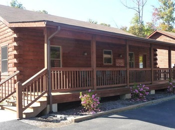 Cabin exterior at Wilderness Presidential Resorts.