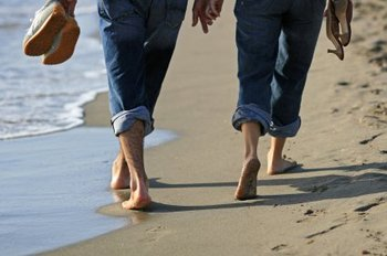 Walking barefoot on the beach at Caribbean Resort & Villas.