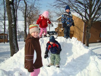 Kids playing in the snow at Train Bell Resort.