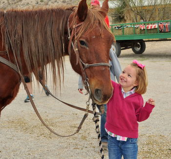 Child with horse at Lajitas Resort.