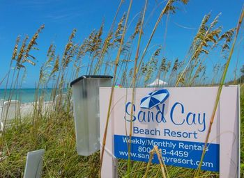 Sand Cay Beach Resort sign.
