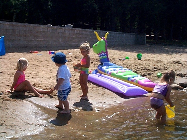 Kids playing on the beach at Black Pine Beach Resort.