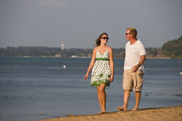 Couple walking on beach at Tamarack Lodge.