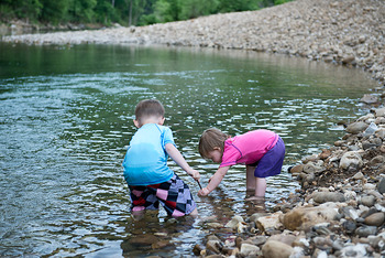 Kid's playing in the water at Buffalo Outdoor Center.