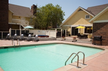 Outdoor pool at Chase Suites Hotel Kansas City.
