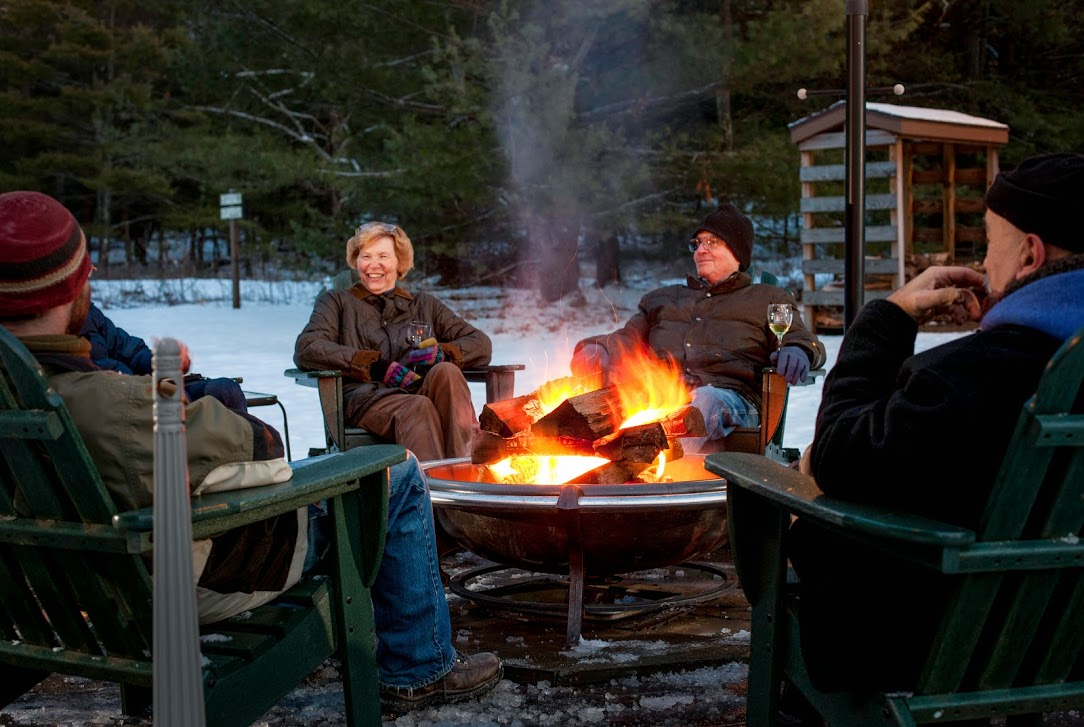 Relaxing by the bonfire at Inn At Lake Joseph.