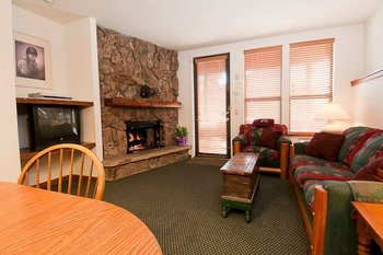 Living Room with Fireplace at  Wildwood Inn