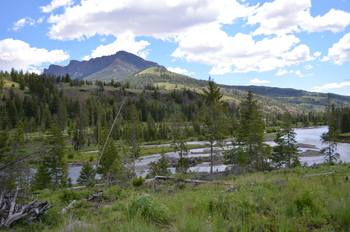 Mountain view by the river at Shoshone Lodge & Guest Ranch.