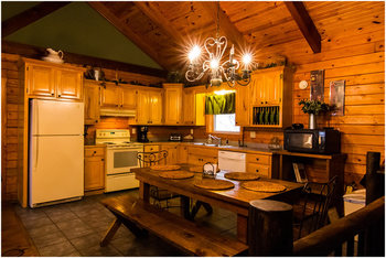 Cabin kitchen at Whispering Hills Cabins.