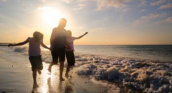 Family on beach at Beachwoods.