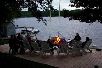 Family around the bonfire at Sir Sam's Inn.
