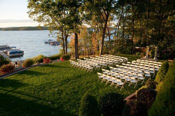 Outdoor wedding by lake at Ehrhardt's Waterfront Resort.