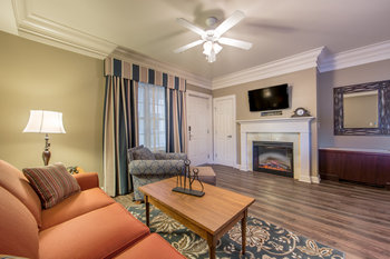 Guest living room with fireplace at Holiday Inn Club Vacations Williamsburg Resort.