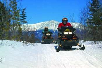 Snowmobiling at New England Outdoor Center.