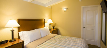 Guest Room at Red Cottage Inn & Suites