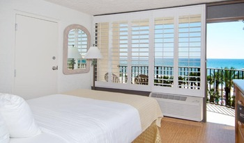Gulf Front private balcony has 1QN Bed semi private w/ 2 sets of bunk beds,  features a full size fridge and microwave.