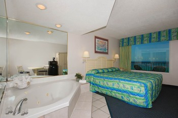 Guest room with jacuzzi at Beachcomber by the Sea.