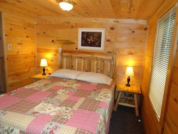 Cabin bedroom at Northern Lights Lodge & Resort.