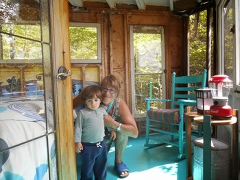 At the door of the tree house on Badour Island