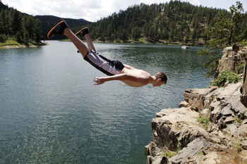 Diving in Pactola Lake near Silver Mountain Resort and Cabins.