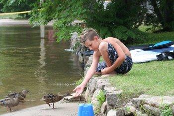 Feeding ducks at Patterson Kaye Resort.