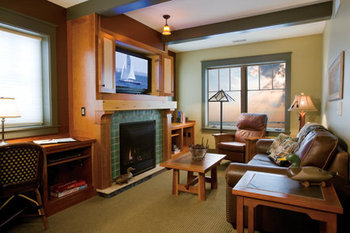 Guest room with fireplace at Tamarack Lodge.