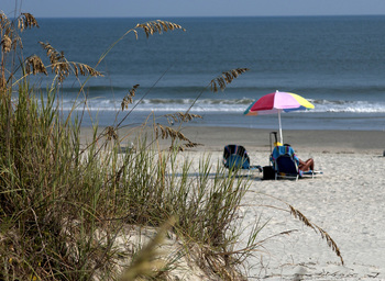 Relaxing on the beach at Ocean Isle Inn.