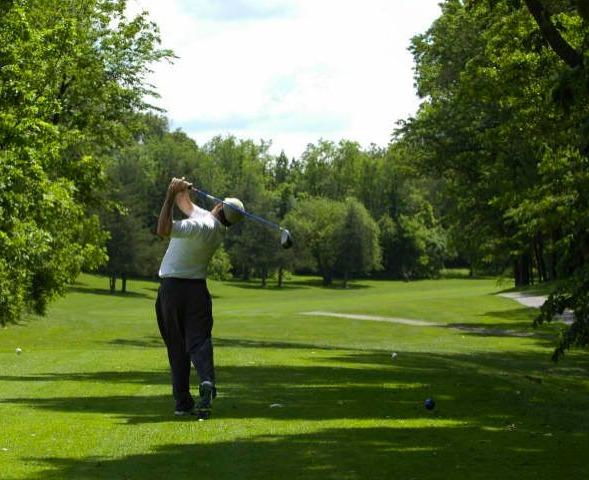 Playing golf at Nemacolin Woodlands Resort.