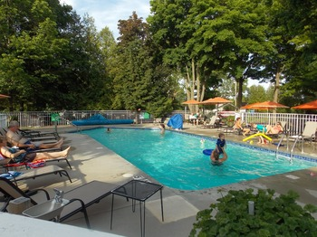 Outdoor pool at Waterbury Inn Condominium Resort.