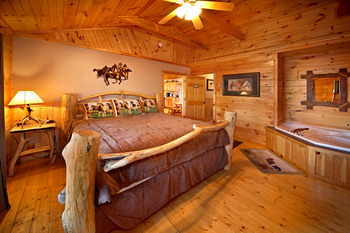 Cabin bedroom at SmokyMountains.com.