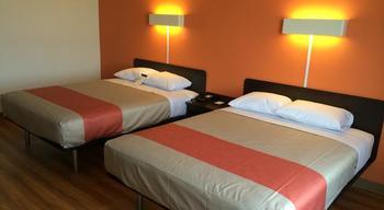 Guest room at Ambassador Hotel & Suites.