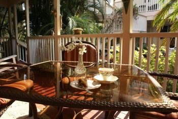 Dining on the porch at Sabal Palm House B & B.
