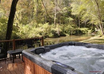 Rental hot tub at Enchanted Mountain Retreats, Inc.