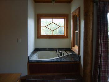 Master Bedroom Jetted Tub in Heron Creek Suites.