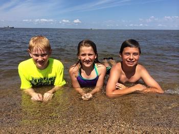 Family in lake at Arnesen's Rocky Point Resort.