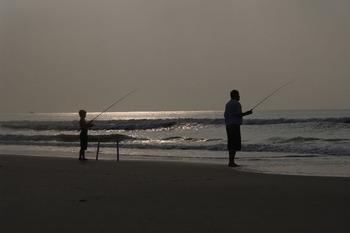 Fishing on the beach at Ocean Isle Inn.