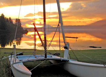 Boat over sunset at Rain Forest Resort.